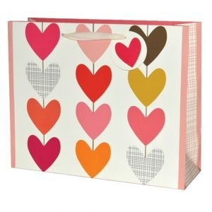 A large gift bag that is covered in colourful hearts printed on it. With a natural ribbon handle and a heart gift tag.