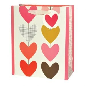 A ,edium sized gift bag which is covered with multi coloured hearts. The bag has a natural coloured ribbon handle with a circular tag and a pink heart printed on it.