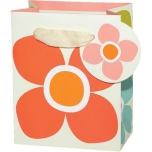 A small gift bag which has a large flower printed on the front of it and has a natural ribbon as a handle and a circular tag which also has a flower printed on it.
