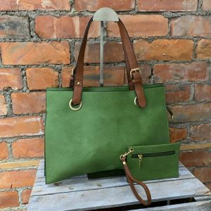 A large zip topped shoulder bag in green with brown shoulder straps. a small coin purse is included.