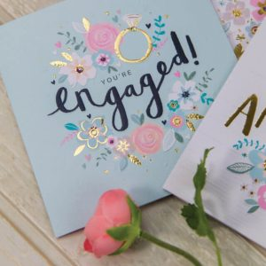 This beautiful engagement card combines pretty florals with bold hand drawn typography for a fresh, contemporary feel. This card is delicately finished with hand applied shimmering jewels, gold foil and embossed details.