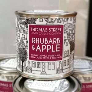 A hand poured rhubarb and apple scented soy wax candle in a tin from Thomas Street. Hand poured in England