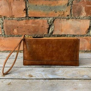 Large brown ladies purse. Could be used as a clutch bag. With 2 zipped sections and a zipped pocket on the reverse and a wrist strap