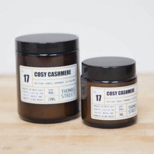 A brown Apothecary jar candle with the aroma called Cosy Cashmere.