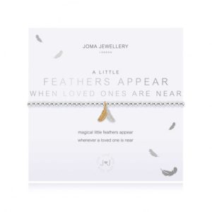 A silver plated bracelet with a a silver and gold feather charm on it. The bracelet is on a white card printed with the words Feathers Appear when Loved Ones are near.