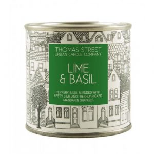 A hand poured lime and basil scented soy wax candle from Thomas Street. Hand poured in England