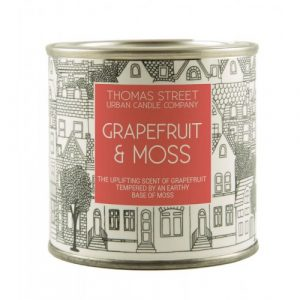 A hand poured grapefruit and moss scented soy wax candle from Thomas Street. Hand poured in England