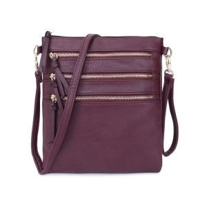 A wine coloured shoulder bag or cross body bag from Long and Sons with a multiple zip feature.