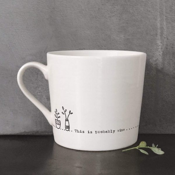 A cream ceramic mug with a black line drawing of a vase of flowers and the words, this is probably wine. Comes in a gift box