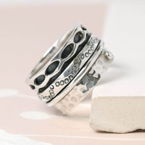 Hand crafted spinning ring made from fine quality sterling silver with decorative edges and double silver moving bands