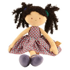 a lovely rag doll with black hair and a pretty dress. She is a perfect gift for a little girl