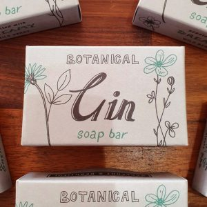 Botanical gin soap bar. 100% vegan. Scented with dreamy wild berry and in a gift box with Botanical gin text and drawings of plants.