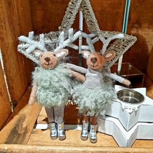 A pair of standing felt deer. Both in silver trousers and boots and a pale green furry outfit. Silver sparkly antlers.
