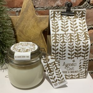 A coffee and walnut scented candle from Agnes and Cat. Comes in a kilner jar and is packaged in a colourful bag held closed with a bulldog clip.