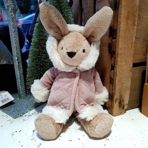 A caramel brown soft cuddly bunny from Jellycat. All ready for a chilly day she is wearing a dusky pink coat with white fur cuffs and collar.