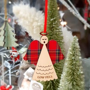 A wooden angel tree decoration with red tartan wings and halo and Low Fell on the dress