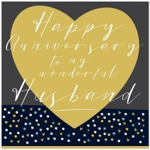 A husband anniversary card with a big gold heart on a dark background and happy anniversary to my wonderful husband