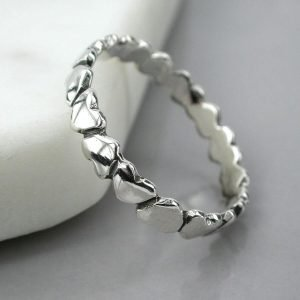 A sterling silver ring made of a line of little silver hearts.