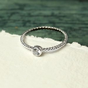 A silver twisted ring with a clear crystal. Great for stacking with your other rings or wearing alone.