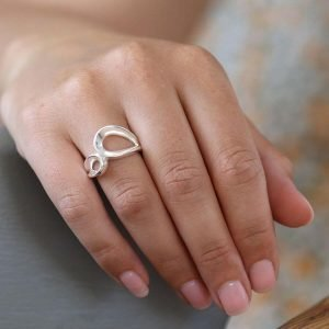 A contemporary chunky silver ring with a double loop