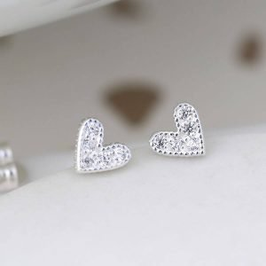 A pair of silver heart stud earrings with cubic zirconia crystals