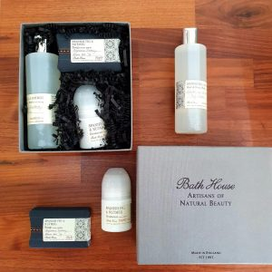 A men's spanish fig and nutmeg shower set containing soap, hair and body wash and deodorant. made with natural ingredients