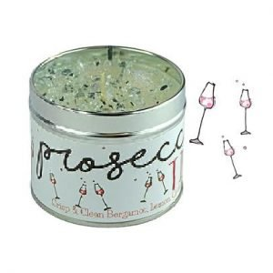 A tin candle with glitter in the top of it and the wording Prosecco time printed on the label.