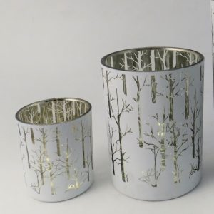 White and gold candle votives with trees