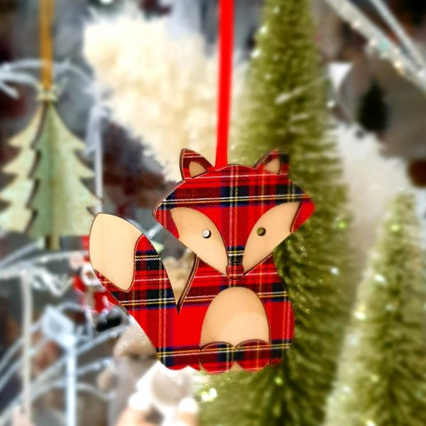 A wooden hanging fox decoration in natural wood and tartan
