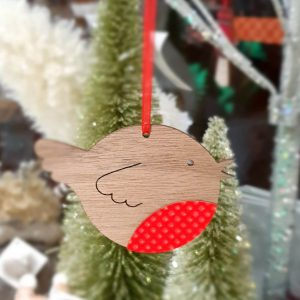 A wooden robin hanging decoration. With a beautiful red breast and red hanging ribon.