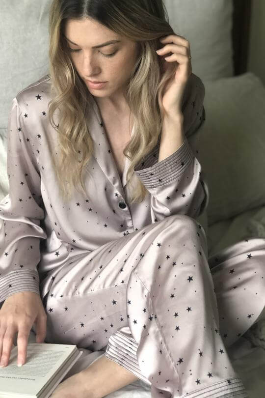 Champagne ladies pyjama set printed with contrasting little black stars. Luxury pyjamas with a long sleeved button up shirt and long drawstring trousers. Beautifully presented in a white gift box
