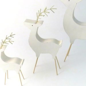 A white wood reindeer with gold legs and antlers