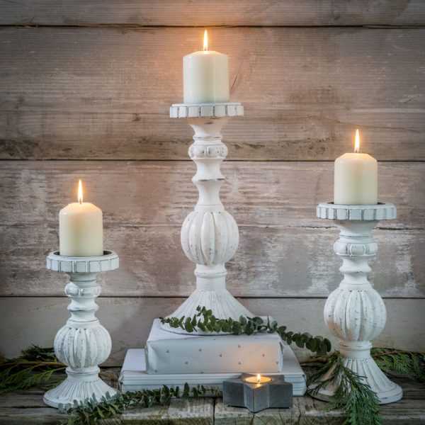 White wooden distressed look candlesticks in small medium and large