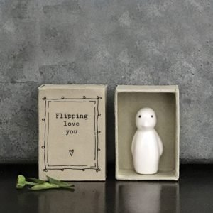 A sweet little porcelain penguin keepsake kept in a little cardboard matchbox with the wording 'Flippin Love You' printed on it.