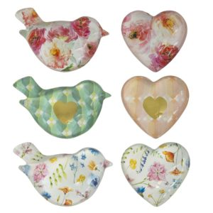 A collection of different designed paperweights in either a bird or a heart shape