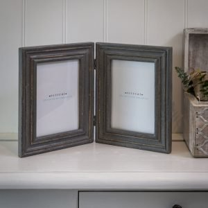 A lovely distressed grey double frame with a hinge for photographs sized 5 x 7 from Retreat Home