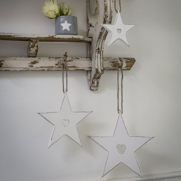 White distressed hanging star with cut out heart in 3 different sizes
