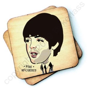 A wooden rustic coaster from Wotmalike with a characterised imahe of Paul McCartney.