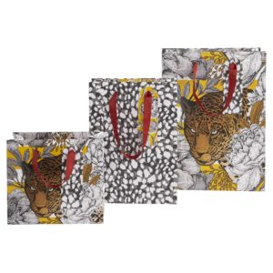 A set of three gift bags that are leopard related, 2 with images of leopards on them and one with a leopard print design. Each bag has a yellow theme and red ribbon handles.