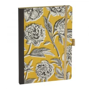 A soft backed mustard coloured flower design note book with elastic band as a pen holder and elastic band around the book as a bookmark.