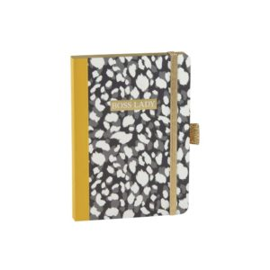 An A6 notebook from German design company Artebene, with a leopard print theme and a yellow spine. The book has Bodd Lady printed on the front of it in gold and there is an elasticated gold strap as a bookmark.