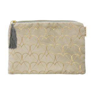 A cream velvet pouch from German design company Artebene. Printed with gold hearts all over it. With a brass zip and a grey coloured tassel.
