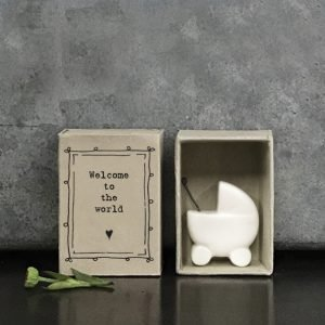 A lovely little ceramic keepsake of a babies pram. The keepsake is kept in a cardboard matchbox with the words Welcome to the World printed on it.