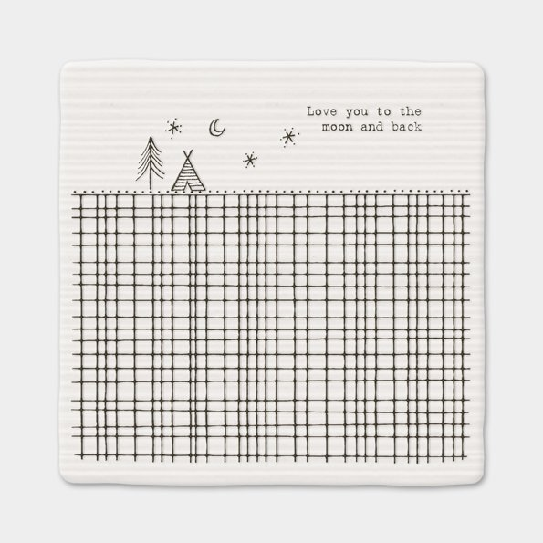 A white ceramic square coaster with an image of a field, a tent a tree, the moon and stars and the wording 'Love you to the moon and back' printed on it.