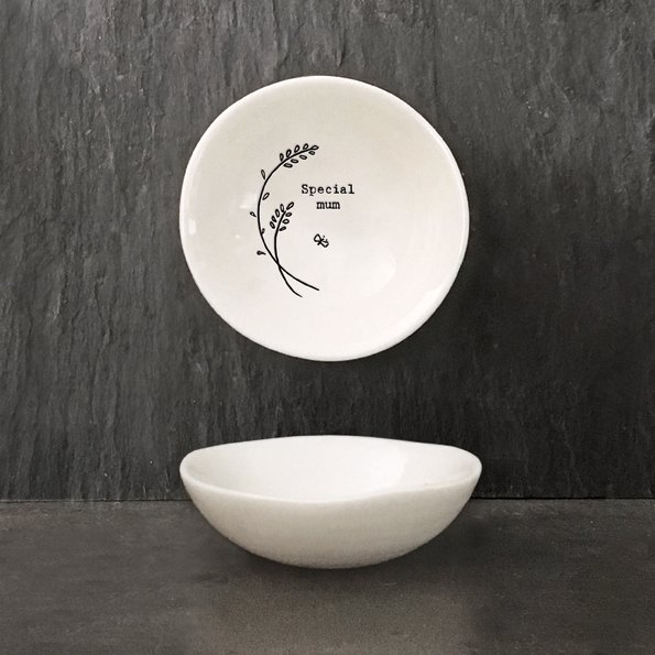 A white ceramic trinket dish from design company East of India. With an image of a flower image and the words Special Mum imprinted on it.
