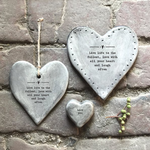 A rustic grey hanging heart with the words ' Live life to the fullest, love with all your heart and laugh often.