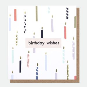 A white card with colourful candles embossed and printed all over it with the words Birthday Wishes printed in the centre of it.