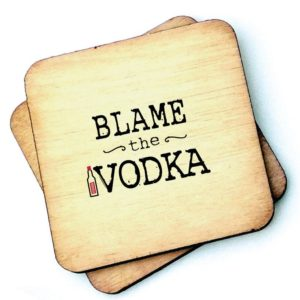 A wooden rustic coaster from Wotmalike with the wording 'Blame the Vodka' printed on it.