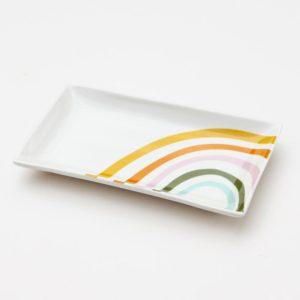 A gorgeous bone china trinket dish with a colourful rainbow design from British designer Caroline Gardner