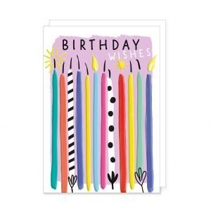 A brightly coloured birthday card with lots of candles in all different colours and the words birthday wishes